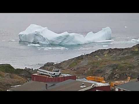 Big iceberg capsizing at Tasiilaq, East Greenland