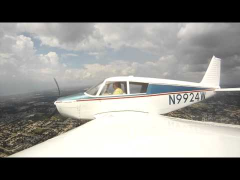 Chris Ondo flying a Piper 140 airplane in Orlando Florida