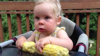 Baby loves her Iowa sweet corn