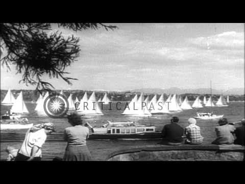 People watch the Yacht race at the inauguration of the sailing season on lake Was...HD Stock Footage