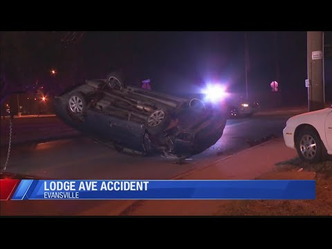 Car overturns in front of Evansville's Lodge Community School