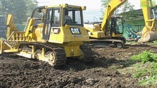 CAT 320D and CAT D6G2 XL Excavating Heavy Equipment Graveyard