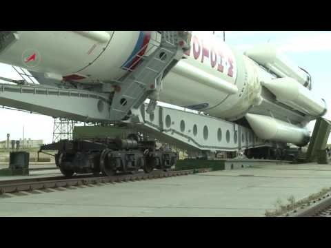 A Proton-M Rocket Carrying the Intelsat DLA-2 Satellite is Transported to the Pad