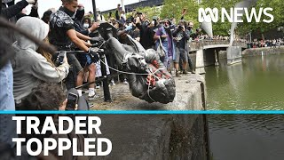 protesters bring down statue of slave trader and dump it in river In UK George Floyd protests
