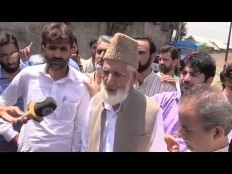 Chairman APHC Syed Ali Geelani arrested by police outside his residence.