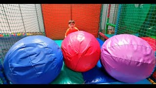 Kids Hide and Seek at the Play Area with Balls and Slides