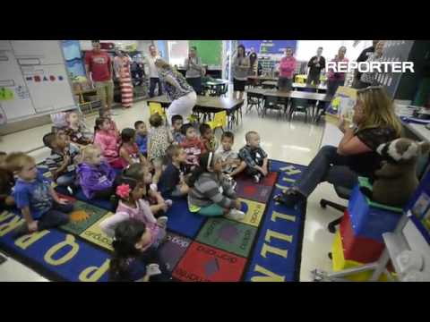 "Gretchen Higgins Elementary School teacher, Penny Casalegno reads, ""The Night Before Kindergarten"" t"
