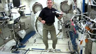 Station Astronauts Do Experiment for