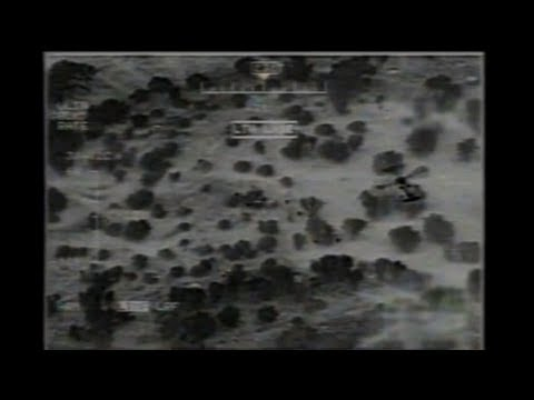 UAV Surveillance Drone Video of Helicopter Tracking Insurgents or Illegal Immigrants Crossing Border