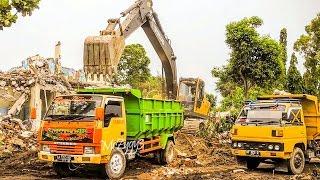 Dump Trucks Loading Dirt By Volvo EC210B Excavator