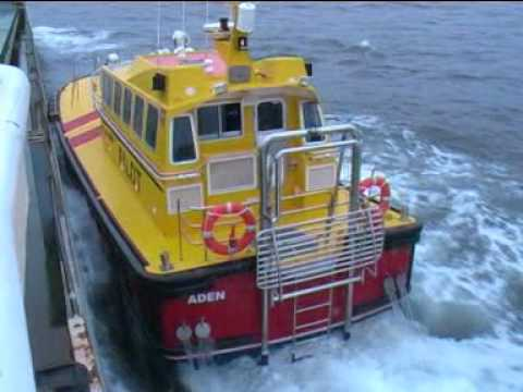 Port of Aden pilot boat boarding low freeboard coaster, rolling.mpg