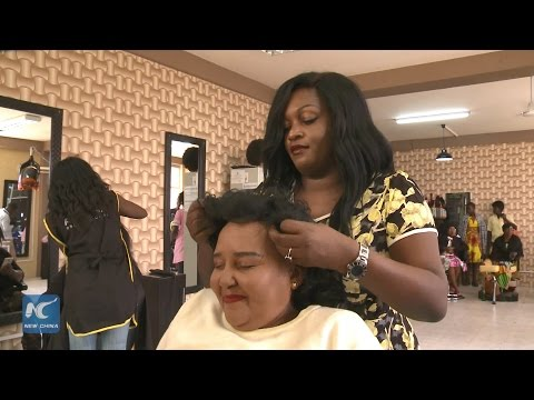 African Hairdresser Puts A Smile On Cancer Patients' Face
