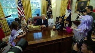 Trump throws jabs at journalists in front of Halloween-clad kids