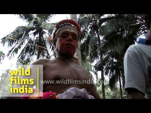 Theyyam artists getting dressed up, Kerala