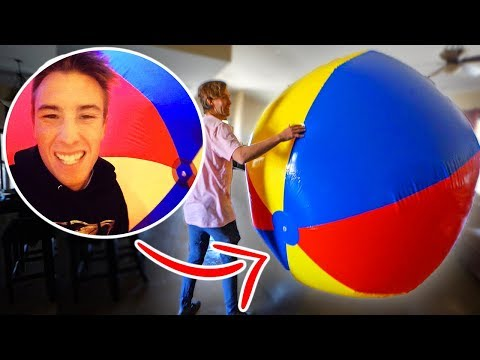 HE'S INSIDE A 12FT BEACH BALL! (JUMPED IN POOL)