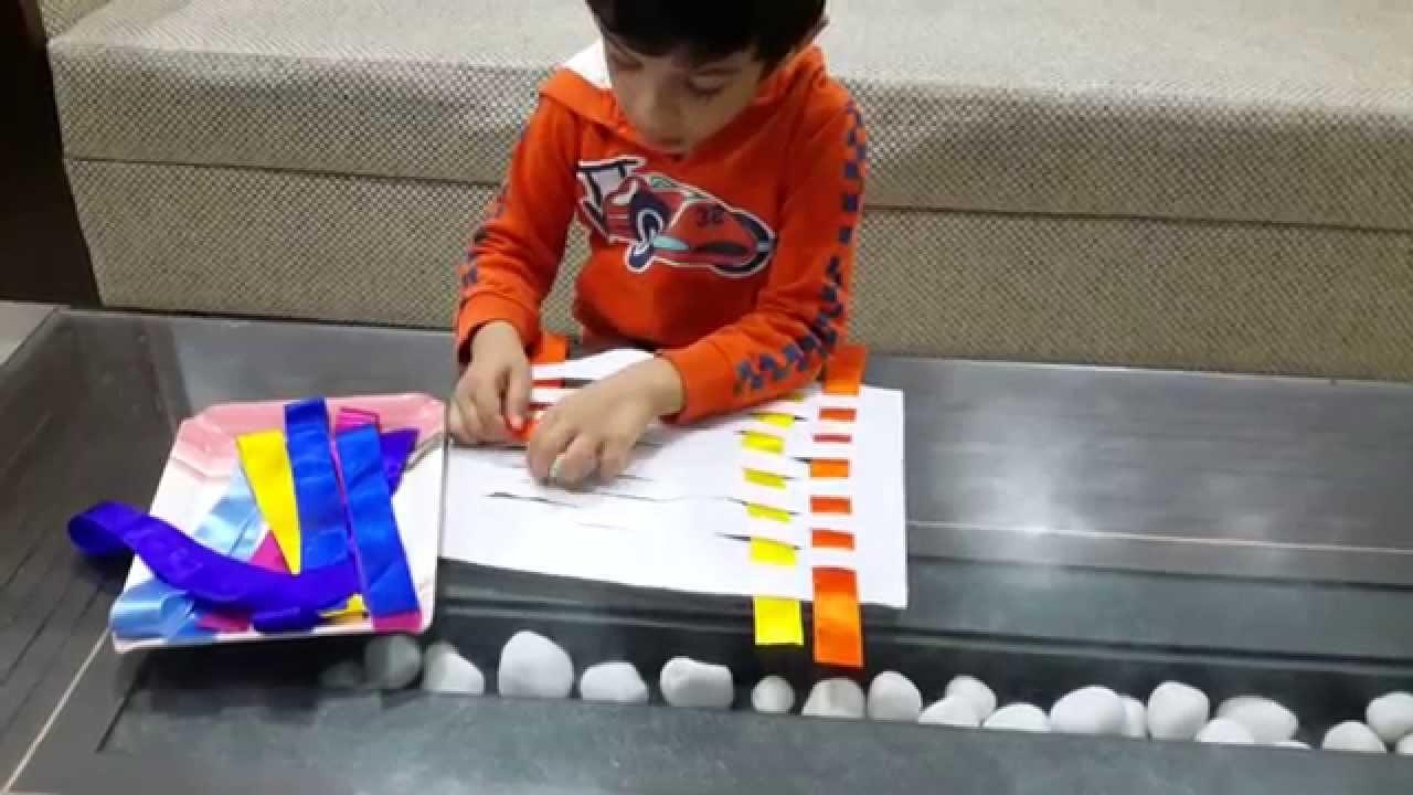 Moksh 39 s weaving activity 1 montessori froebel inspired for Montessori fine motor skills