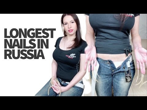 Woman with Longest Nails in Russia Shows How She Puts Her Jeans On