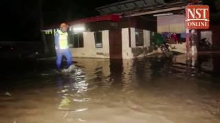 20 houses in knee-deep water as high tide strikes Penang