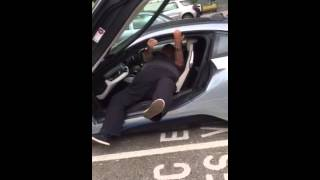 fat man gets out of bmw i8