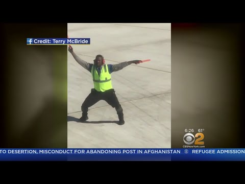 Airport Worker Wows Plane Passengers With Routines
