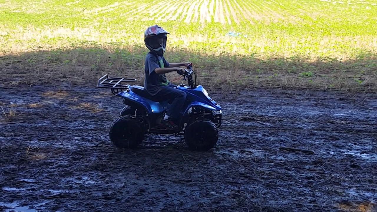 My boy mudding on his Tao Tao 110cc ATV Kids 4 Wheeler PGNETWORK