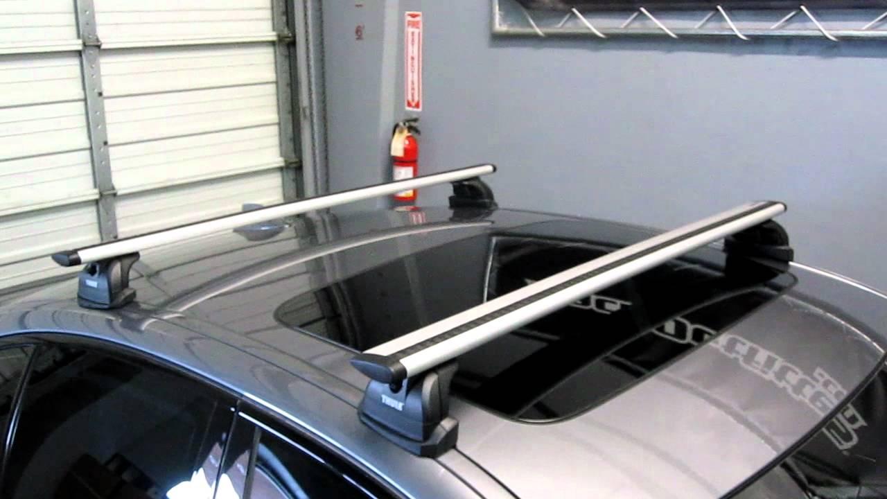 BMW 5 Series Sedan with Thule 460R Podium AeroBlade Base ...
