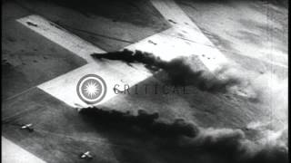 US bombers strafe a Japanese tanker and crash landings of American pilots on an a...HD Stock Footage