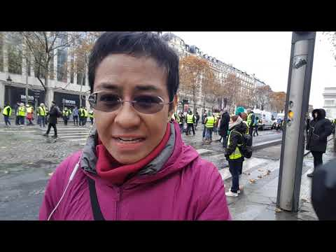 "Maria Ressa at Champs-Élysées during  ""yellow vest"" protest"