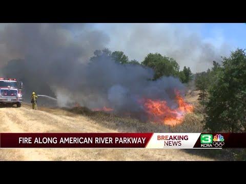Fire burns along American River Parkway in Sacramento County