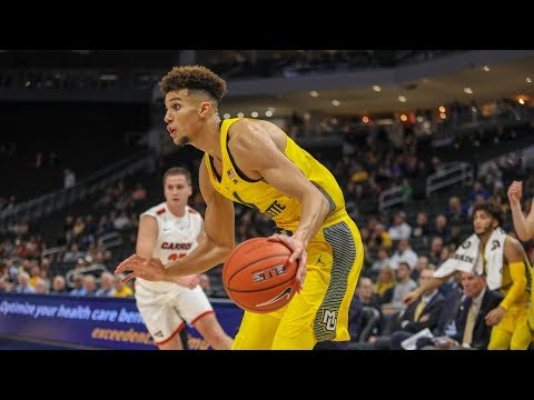 Marquette Courtside - Marquette tops Carroll in exhibition play 87-44