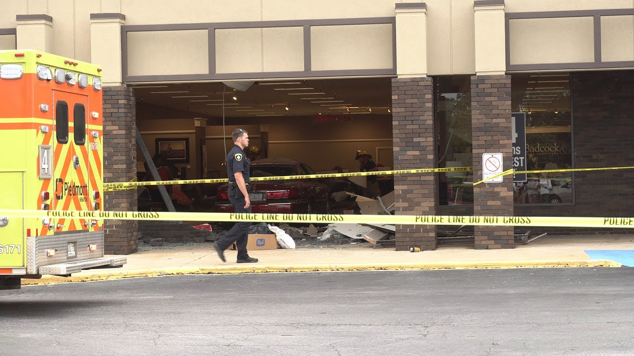 Car crashes through Badcock Furniture store building while
