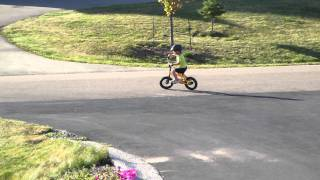 My two year old riding his pedal bike with no training wheels.