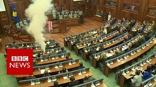 Tear gas set off in Kosovo parliament - BBC News