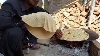 Tawa Roti in village style/man making  vry big chapati
