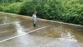 Boy with rain boots. What could go wrong?