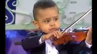 A young kid playing violin