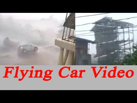 Vardah Cyclone: Car fly away, building collapsed; Watch video | Oneindia News