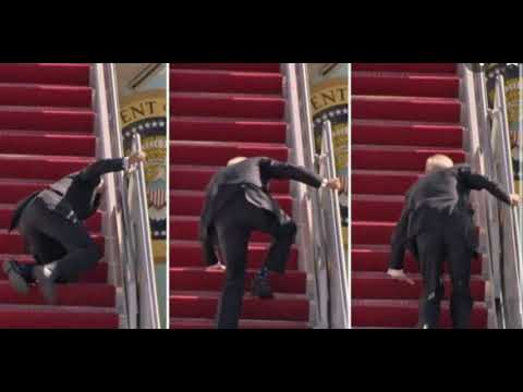 President Joe Biden Attempting To Climb The Steps