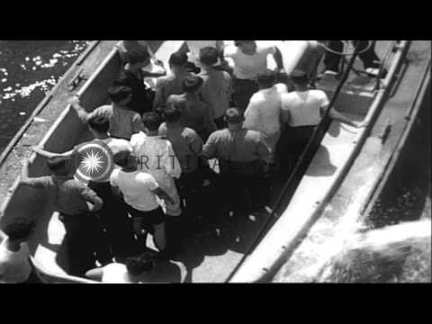 Rescue of survivors from collision between HMAS Melbourne and destroyer USS Frank...HD Stock Footage