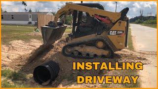 installing culvert pipe for driveway using CAT 259D skid steer
