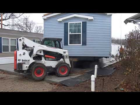 Part 3: Situating home on lot: Using the Bobcat for precise movement www.MyHomeinEdison.com