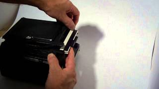 Graflex film holder insertion and removal
