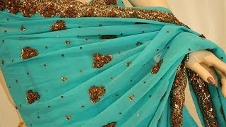 Teal saree with brass gold emboridery movie Thumbnail