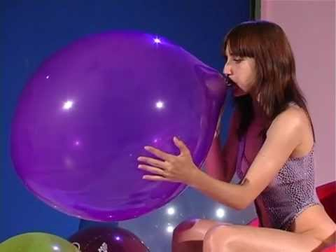 sexy women popping balloons