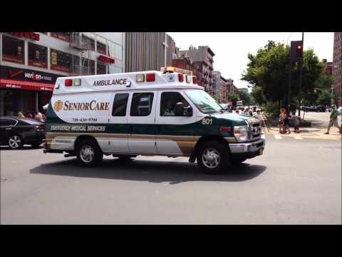 SENIOR CARE EMS AMBULANCE RESPONDING ON W. 125TH ST. IN HARLEM AREA OF MANHATTAN IN NEW YORK CITY.