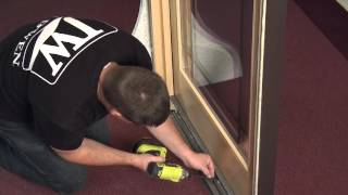 how to remove and reinstall a stationary panel in a sliding wood patio door