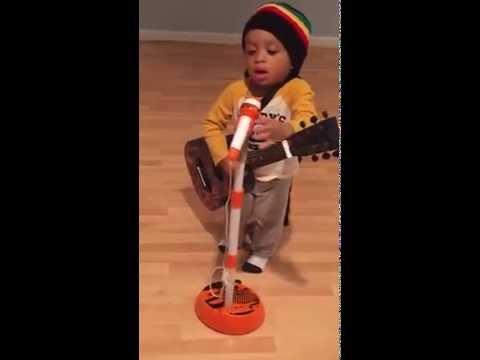 little boy named Myles Kingston sing a song Bob Marley