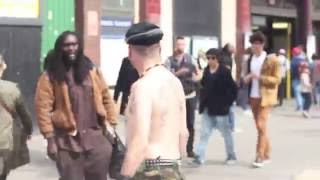 CRAZY racist man tries to fight two rastamen calls them black cu** and rasta goes crazy