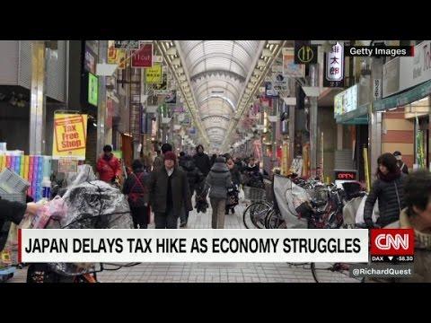 Japan delays tax hike as economy struggles