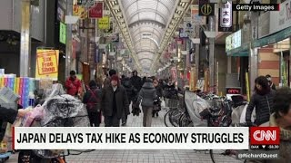 Japan delays tax hike as economy struggles